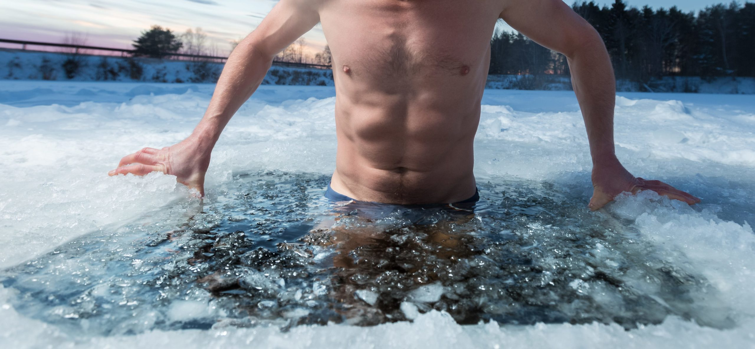 Photo of a man in freezing ice cold water.
