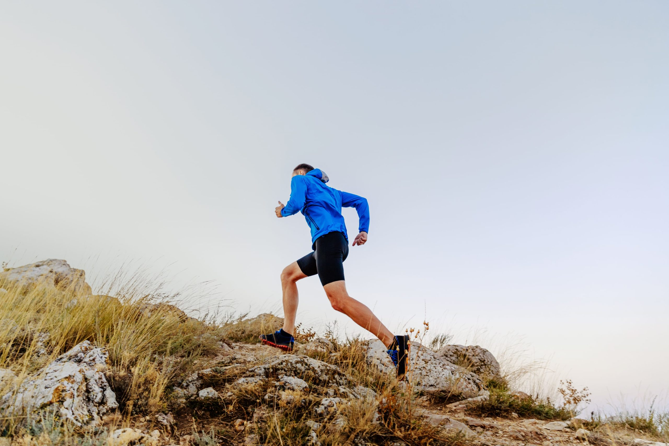 Picture of a man running up a hill challenging himself.